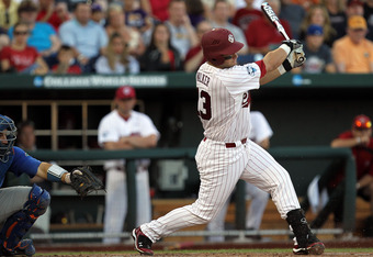 OMAHA, NE - JUNE 28:  Christian Walker #13 of the South Carolina Gamecocks at bat against the Florida Gators during game 2 of the men's 2011 NCAA College Baseball World Series at TD Ameritrade Park Omaha on June 28, 2011 in Omaha, Nebraska.  (Photo by Ron