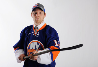 PITTSBURGH, PA - JUNE 22:  Griffin Reinhart, drafted fourth overall by the New York Islanders, poses for a portrait during Round One of the 2012 NHL Entry Draft at Consol Energy Center on June 22, 2012 in Pittsburgh, Pennsylvania.  (Photo by Jamie Sabau/G