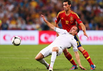 DONETSK, UKRAINE - JUNE 23: Alvaro Arbeloa of Spain and Franck Ribery of France challenge for the ball during the UEFA EURO 2012 quarter final match between Spain and France at Donbass Arena on June 23, 2012 in Donetsk, Ukraine.  (Photo by Alex Livesey/Ge