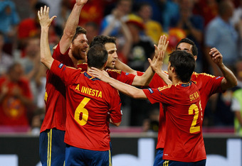 DONETSK, UKRAINE - JUNE 23:  Xabi Alonso (L) of Spain celebrates after scoring the first goal with team mates during the UEFA EURO 2012 quarter final match between Spain and France at Donbass Arena on June 23, 2012 in Donetsk, Ukraine.  (Photo by Laurence