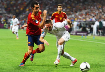 DONETSK, UKRAINE - JUNE 23:  Franck Ribery of France falls under the challenge by Alvaro Arbeloa of Spain during the UEFA EURO 2012 quarter final match between Spain and France at Donbass Arena on June 23, 2012 in Donetsk, Ukraine.  (Photo by Laurence Gri