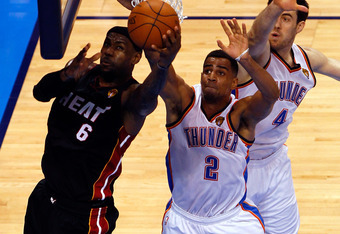 OKLAHOMA CITY, OK - JUNE 14:  LeBron James #6 of the Miami Heat goes up for a shot against Nick Collison #4 and Thabo Sefolosha #2 of the Oklahoma City Thunder in the first quarter in Game Two of the 2012 NBA Finals at Chesapeake Energy Arena on June 14,