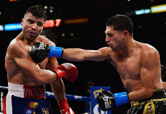 LOS ANGELES, CA - JUNE 23: Josesito Lopez lands a right punch to the jaw of Victor Ortiz during the 12-round fight for the vacant WBC Silver Welterweight Championship at Staples Center on June 23, 2012 in Los Angeles, California.  Lopez won by TKO after b
