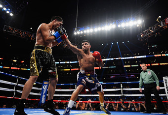 LOS ANGELES, CA - JUNE 23:  Victor Ortiz lands a right hook against Josesito Lopez during the 12-round fight for the vacant WBC Silver Welterweight Championship at Staples Center on June 23, 2012 in Los Angeles, California.  (Photo by Kevork Djansezian/Ge