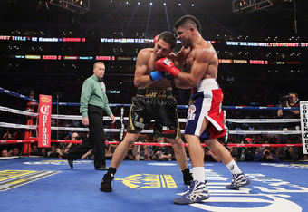 LOS ANGELES, CA - JUNE 23:  Victor Ortiz lands a left hand to the head of Josesito Lopez during their WBC Silver Welterweight title fight at Staples Center on June 23, 2012 in Los Angeles, California.  (Photo by Jeff Gross/Getty Images for Golden Boy Prom