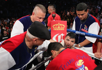 LOS ANGELES, CA - JUNE 23:  Victor Ortiz has his jaw iced following his WBC Silver Welterweight title fight against Josesito Lopez at Staples Center on June 23, 2012 in Los Angeles, California.  (Photo by Jeff Gross/Getty Images for Golden Boy Promotions)