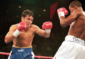 18 Sep 1999:  Oscar De La Hoya prepares to throw a right at Felix Trinidad during their welterweight title fight at the Mandalay Bay Casino in Las Vegas, Nevada. Trinidad won the fight by decision. Mandatory Credit: Al Bello  /Allsport