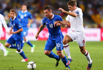KIEV, UKRAINE - JUNE 24: Antonio Cassano of Italy and Steven Gerrard of England challenge for the ball during the UEFA EURO 2012 quarter final match between England and Italy at The Olympic Stadium on June 24, 2012 in Kiev, Ukraine.  (Photo by Alex Livese