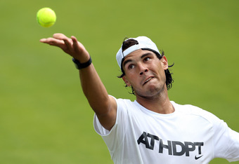 LONDON, ENGLAND - JUNE 24:  Rafael Nadal of Spain serves in a practice session during previews for the Wimbledon Championships 2012 at Wimbledon on June 24, 2012 in London, England.  (Photo by Julian Finney/Getty Images)