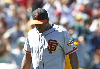 OAKLAND, CA - JUNE 24: Santiago Casilla #46 of the San Francisco Giants reacts after giving up a three-run home run to Derek Norris #36 of the Oakland Athletics (not pictured) during the ninth inning of an interleague game at O.co Coliseum on June 24, 201