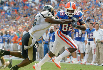 GAINESVILLE, FL - NOVEMBER 21: Wide receiver Omarius Hines #82 of the Florida Gators rushes upfield with a pass for a touchdown against the Florida International University Golden Panthers, November 21, 2009 at Ben Hill Griffin Stadium in Gainesville, Flo