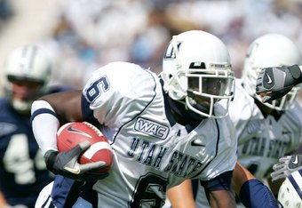 PROVO, UT - SEPTEMBER 23:  Kevin Robinson #6 of the Utah State Aggies runs with the ball against the Brigham Young Cougars on September 23, 2006 at La Vell Edwards Stadium in Provo, Utah.  (Photo By Kent Horner/Getty Images)