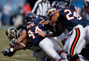 CHICAGO - DECEMBER 06: Members of the Chicago Bear defense including Kevin Payne #44 and Al Afalava #24 gang-tackle Steven Jackson #39 of the St. Louis Rams at Soldier Field on December 6, 2009 in Chicago, Illinois. (Photo by Jonathan Daniel/Getty Images)