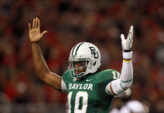 ARLINGTON, TX - NOVEMBER 26:  Robert Griffin III #10 of the Baylor Bears celebrates a touchdown against the Texas Tech Red Raiders at Cowboys Stadium on November 26, 2011 in Arlington, Texas.  (Photo by Ronald Martinez/Getty Images)