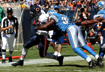 CHICAGO - SEPTEMBER 12: Matt Forte #22 of the Chicago Bears is hit by Aaron Berry #32 of the Detroit Lions during the NFL season opening game at Soldier Field on September 12, 2010 in Chicago, Illinois. The Bears defeated the Lions 19-14. (Photo by Jonath