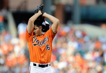 BALTIMORE, MD - JUNE 23:  Wei-Yin Chen #16 of the Baltimore Orioles reacts during a game against the Washington Nationals at Oriole Park at Camden Yards on June 23, 2012 in Baltimore, Maryland.  (Photo by Patrick McDermott/Getty Images)