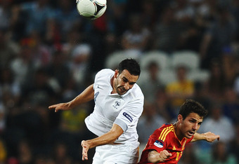 DONETSK, UKRAINE - JUNE 23:  Adil Rami of France and Cesc Fabregas of Spain jump for the ball during the UEFA EURO 2012 quarter final match between Spain and France at Donbass Arena on June 23, 2012 in Donetsk, Ukraine.  (Photo by Laurence Griffiths/Getty