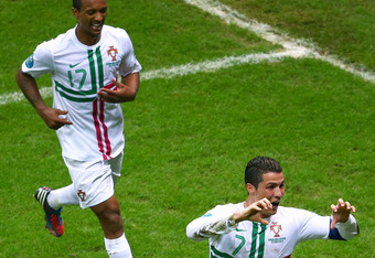WARSAW, POLAND - JUNE 21:  Cristiano Ronaldo of Portugal (R) celebrates scoring the opening goal with team mate Nani during the UEFA EURO 2012 quarter final match between Czech Republic and Portugal at The National Stadium on June 21, 2012 in Warsaw, Pola