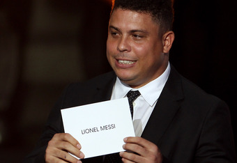 ZURICH, SWITZERLAND - JANUARY 09: Ronaldo of Brasil announces Lionel Messi of Barcelona the winner of the FIFA Ballon d'Or 2011 on January 9, 2012 in Zurich, Switzerland.  (Photo by Scott Heavey/Getty Images)