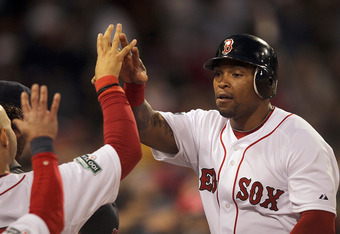 BOSTON, MA - APRIL 30:  Marlon Byrd #23 of the Boston Red Sox celebrates after he scored a run against the Oakland Athletics in the second inning at Fenway Park April 30, 2012  in Boston, Massachusetts. (Photo by Jim Rogash/Getty Images)