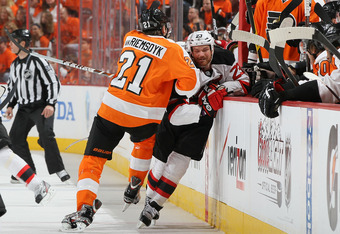 PHILADELPHIA, PA - APRIL 29:  James van Riemsdyk #21 of the Philadelphia Flyers checks David Clarkson #23 of the New Jersey Devils in Game One of the Eastern Conference Semifinals during the 2012 NHL Stanley Cup Playoffs at the Wells Fargo Center on April