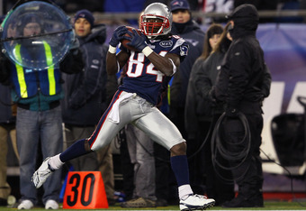 FOXBORO, MA - JANUARY 14:  Deion Branch #84 of the New England Patriots catches a 61-yard touchdown reception in the second quarter against the Denver Broncos during their AFC Divisional Playoff Game at Gillette Stadium on January 14, 2012 in Foxboro, Mas
