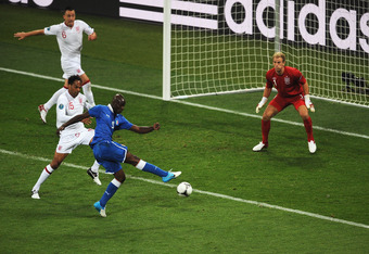 KIEV, UKRAINE - JUNE 24:  Mario Balotelli of Italy shoots towards goal during the UEFA EURO 2012 quarter final match between England and Italy at The Olympic Stadium on June 24, 2012 in Kiev, Ukraine.  (Photo by Christopher Lee/Getty Images)