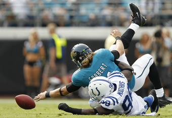 JACKSONVILLE, FL - JANUARY 1: Blaine Gabbert #11 of the Jacksonville Jaguars fumbles the football after being sacked by Robert Mathis #98 of the Indianapolis Colts at EverBank Field on January 1, 2012 in Jacksonville, Florida. The Jaguars defeated the Col