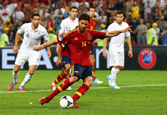 DONETSK, UKRAINE - JUNE 23:  Xabi Alonso of Spain scores the second goal from the penalty spot during the UEFA EURO 2012 quarter final match between Spain and France at Donbass Arena on June 23, 2012 in Donetsk, Ukraine.  (Photo by Martin Rose/Getty Image