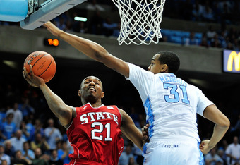 CHAPEL HILL, NC - JANUARY 26:  John Henson #31 of the North Carolina Tar Heels challenges a shot by C.J. Williams #21 of the North Carolina State Wolfpack during play at the Dean Smith Center on January 26, 2012 in Chapel Hill, North Carolina.  (Photo by
