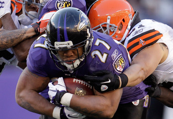 BALTIMORE, MD - DECEMBER 24:  Ray Rice #27 of the Baltimore Ravens is tackled by Chris Gocong #51 of the Cleveland Browns dburing the second half at M&T Bank Stadium on December 24, 2011 in Baltimore, Maryland.  (Photo by Rob Carr/Getty Images)