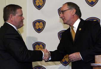 SOUTH BEND, IN - DECEMBER 11: Notre Dame atheletic director Jack Swarbrick (R) greets Brian Kelly as he is introduced as the new football head coach at Notre Dame University on December 11, 2009 in South Bend, Indiana.  Kelly most recently led the Univers