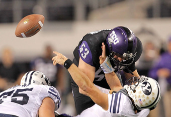 ARLINGTON, TX - OCTOBER 28: Riley Nelson #13 of the BYU Cougars is tackled during a game against the TCU Horned Frogs at Cowboys Stadium on October 28, 2011 in Arlington, Texas.  (Photo by Sarah Glenn/Getty Images)