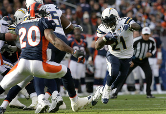 DENVER - NOVEMBER 22:  LaDainian Tomlinson #21 of the San Diego Chargers rushes against the Denver Broncos during NFL action at Invesco Field at Mile High on November 22, 2009 in Denver, Colorado.  (Photo by Doug Pensinger/Getty Images)