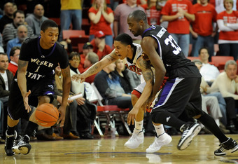 LAS VEGAS - DECEMBER 17:  Tre'Von Willis #33 of the UNLV Rebels goes for a steal between Damian Lillard #1 and Matt Washington #33 of the Weber State Wildcats during their game at the Thomas & Mack Center December 17, 2009 in Las Vegas, Nevada.  (Photo by