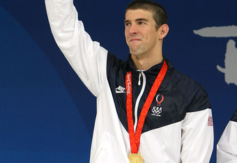 BEIJING - AUGUST 17:  Michael Phelps of the United States waves to the crowd wearing his eighth gold medal during the medal ceremony for the Men's 4x100 Medley Relay at the National Aquatics Centre during Day 9 of the Beijing 2008 Olympic Games on August