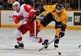 NASHVILLE, TN - APRIL 20:  Mike Fisher #12 of the Nashville Predators collides with Valtteri Filppula #51 of the Detroit Red Wings in Game Five of the Western Conference Quarterfinals during the 2012 NHL Stanley Cup Playoffs at the Bridgestone Arena on Ap
