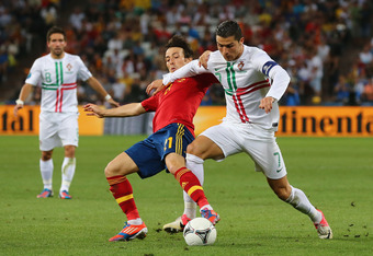 DONETSK, UKRAINE - JUNE 27: David Silva of Spain competes with Cristiano Ronaldo of Portugal  during the UEFA EURO 2012 semi final match between Portugal and Spain at Donbass Arena on June 27, 2012 in Donetsk, Ukraine.  (Photo by Martin Rose/Getty Images)