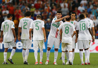 Portugal players hang their heads as they make for the locker room following their defeat.