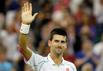 LONDON, ENGLAND - JUNE 27:  Novak Djokovic of Serbia celebrates match point during his Gentlemen's Singles second round match against Ryan Harrison of USA on day three of the Wimbledon Lawn Tennis Championships at the All England Lawn Tennis and Croquet C