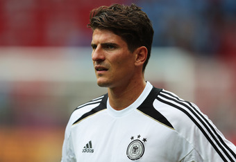 WARSAW, POLAND - JUNE 27: Mario Gomez looks on during a Germany training session ahead of their UEFA EURO 2012 semi-final match against Italy at the National Stadium on June 27, 2012 in Warsaw, Poland.  (Photo by Joern Pollex/Getty Images)