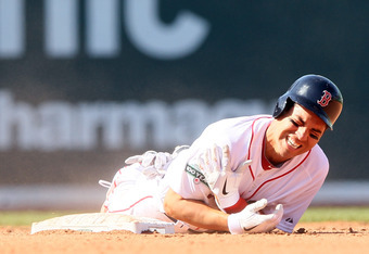BOSTON, MA - APRIL 13:  Jacoby Ellsbury #2 of the Boston Red Sox reacts after he was injured in a double play in the bottom of the fourth inning against the Tampa Bay Rays during the home opener on April 13, 2012 at Fenway Park in Boston, Massachusetts.
