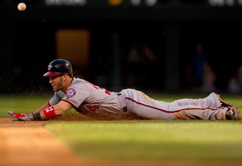 DENVER, CO - JUNE 27:  Bryce Harper #34 of the Washington Nationals slides in safely at second base on a double ahead of the throw during the fourth inning against the Colorado Rockies at Coors Field on June 27, 2012 in Denver, Colorado.  (Photo by Justin