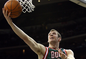 NEWARK, NJ - MARCH 12:  Jon Leuer #30 of the Milwaukee Bucks drives for a shot attempt against the New Jersey Nets at Prudential Center on March 12, 2012 in Newark, New Jersey.  NOTE TO USER: User expressly acknowledges and agrees that, by downloading and