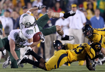 BERKELEY, CA - NOVEMBER 13:  Jeff Maehl #23 of the Oregon Ducks flies through the air after being hit by Josh Hill #23 of the California Golden Bears  at California Memorial Stadium on November 13, 2010 in Berkeley, California.  (Photo by Ezra Shaw/Getty