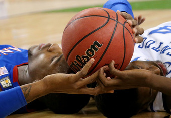 NEW ORLEANS, LA - APRIL 02:  Thomas Robinson #0 of the Kansas Jayhawks and Michael Kidd-Gilchrist #14 of the Kentucky Wildcats lay on the court with the ball between them in the first half in the National Championship Game of the 2012 NCAA Division I Men'