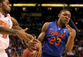 PHOENIX, AZ - MARCH 24:  Chane Behanan #24 of the Louisville Cardinals and Bradley Beal #23 of the Florida Gators battle for a loose ball in the first half during the 2012 NCAA Men's Basketball West Regional Final at US Airways Center on March 24, 2012 in