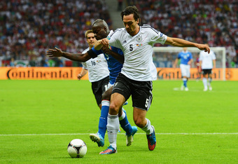 WARSAW, POLAND - JUNE 28: Mario Balotelli (L) of Italy and Mats Hummels of Germany during the UEFA EURO 2012 semi final match between Germany and Italy at the National Stadium on June 28, 2012 in Warsaw, Poland.  (Photo by Shaun Botterill/Getty Images)