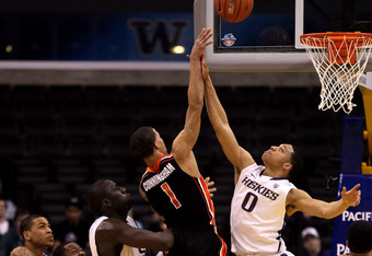 LOS ANGELES, CA - MARCH 08:  Jared Cunningham #1 of the Oregon State Beavers goes up for a shot over Abdul Gaddy #0 of the Washington Huskies in the second half during the quarterfinals of the 2012 Pacific Life Pac-12 basketball tournament at Staples Cent
