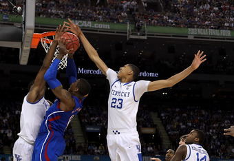 NEW ORLEANS, LA - APRIL 02:  Thomas Robinson #0 of the Kansas Jayhawks goes up for a shot against Terrence Jones #3 and Anthony Davis #23 of the Kentucky Wildcats in the first half in the National Championship Game of the 2012 NCAA Division I Men's Basket